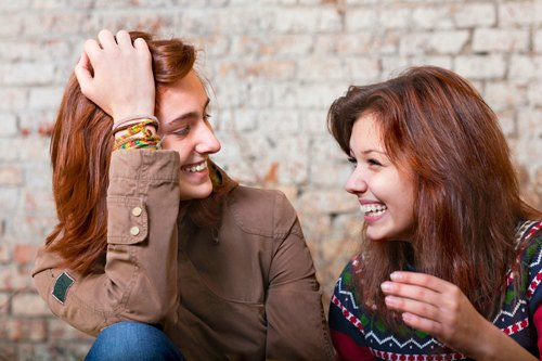 two college students laughing