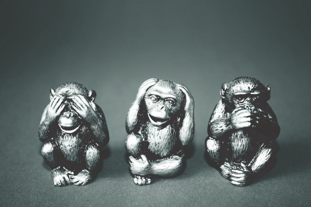 statuettes of monkeys displaying see no evil, hear no evil, speak no evil