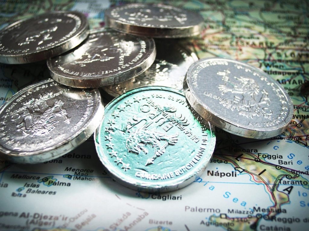 euro coins on top of map