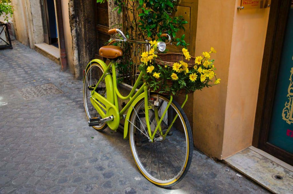 green bike decorated with yellow flowers