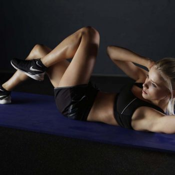 young woman doing bicycle crunches