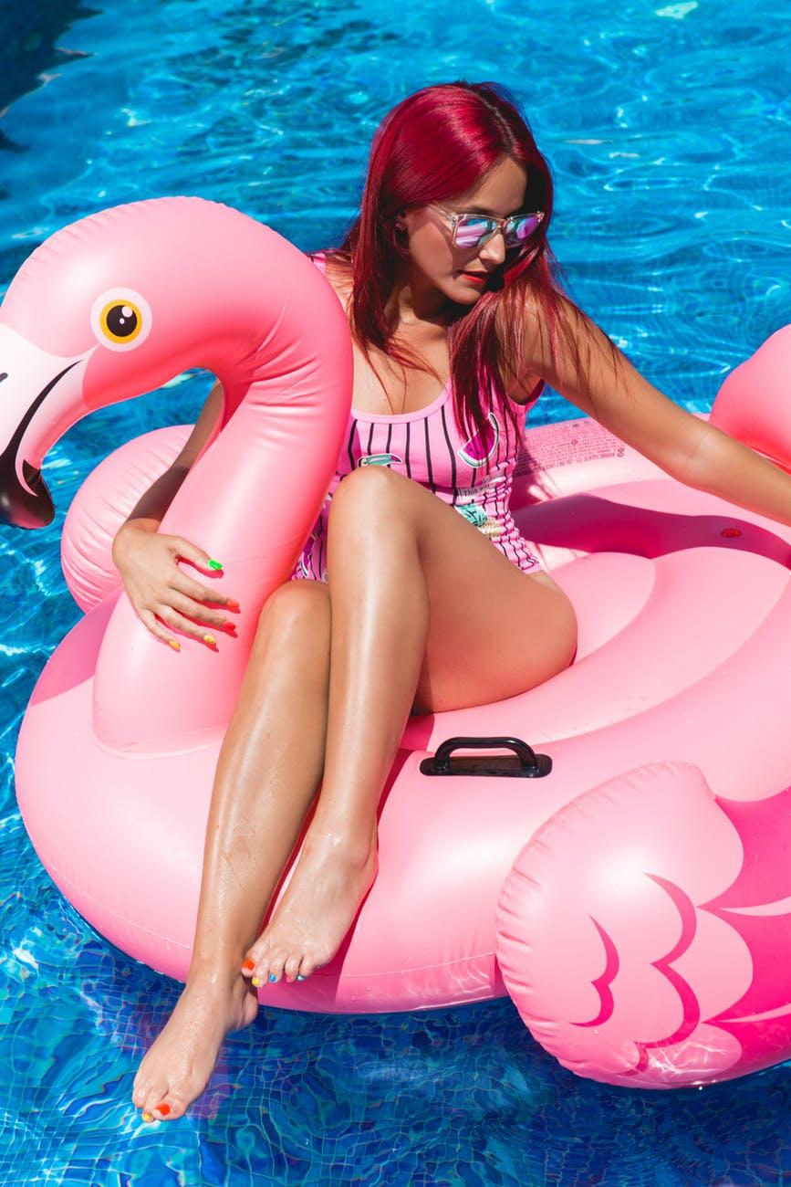 young woman in flamingo floatie