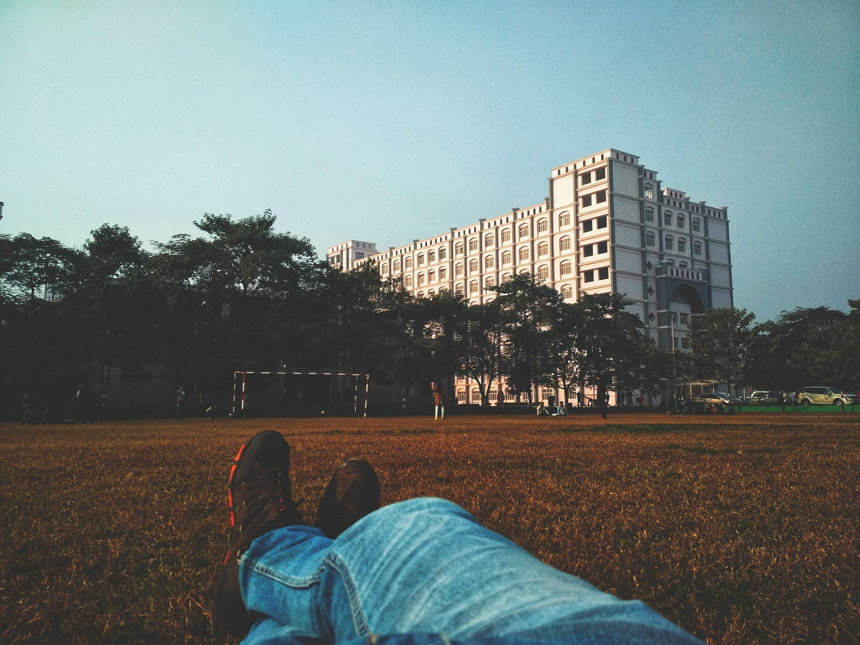 person laying on a soccer fields