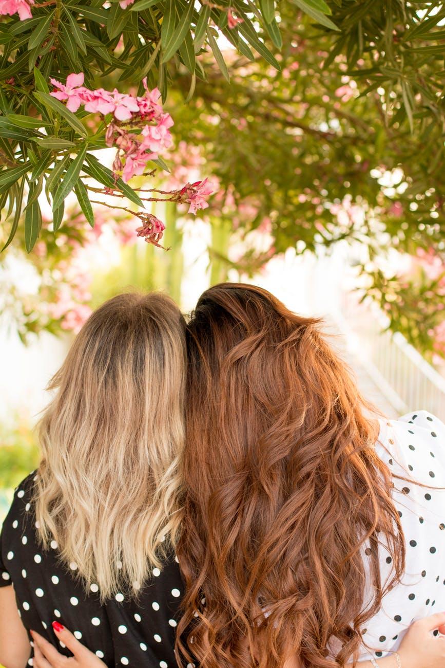 women wearing polkadots hugging