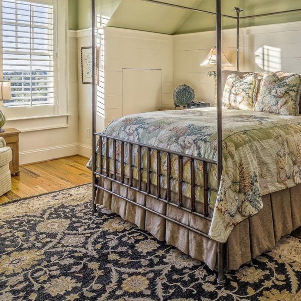 bedroom with hardwood floors and carpet
